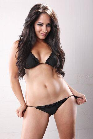 Cute brunette in black bikini