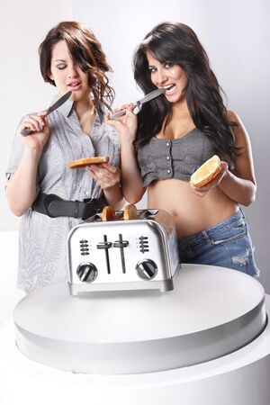 Two young house-wifes using your toast spread photo