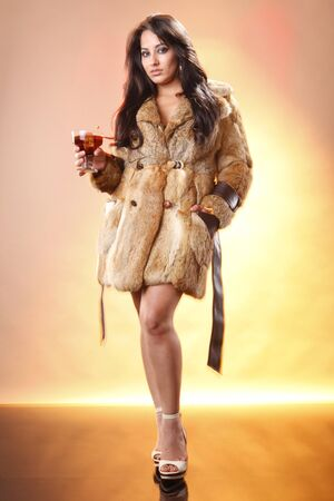Woman in fur coat enjoys a coffee liquor cocktail photo