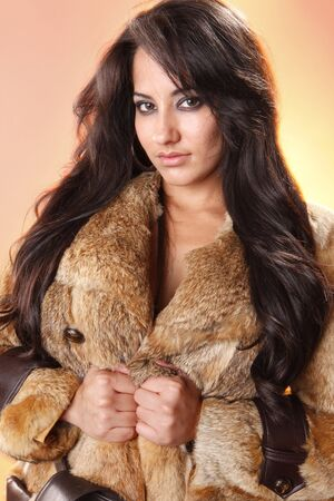 Young woman in fur coat jacket Banque d'images