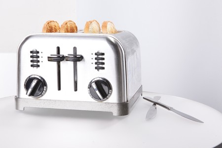 home appliances: Vintage stainless steel toaster and toasts Stock Photo