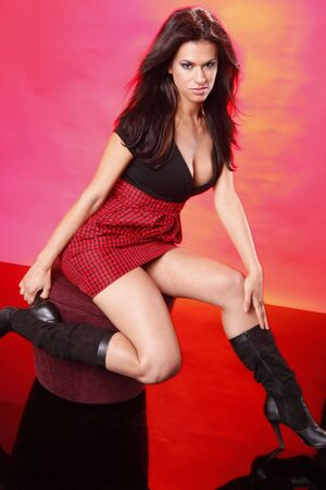 woman mirror: Striking brunette on red setting