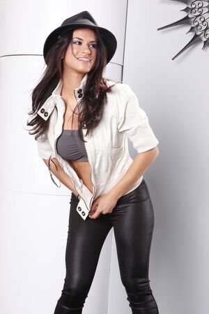spandex: Striking brunette in spandex and white jeans jacket Stock Photo