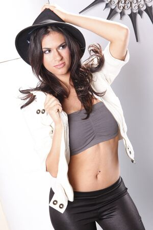 Striking brunette in spandex and white jeans jacket photo