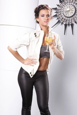 spandex: Striking brunette and white wine glass Stock Photo