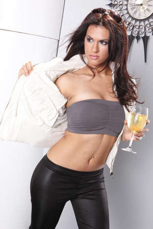 Striking brunette and white wine glass photo