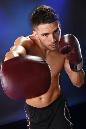 boxing boy: Action boxer in training attitude Stock Photo