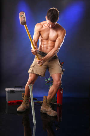 Muscular worker nailing it down Stock Photo - 7719418