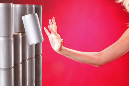 Aluminum can jumping out fron ahelve onto woman's hand Stock Photo - 7719359