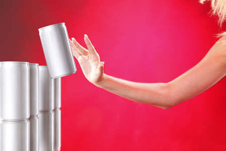 Aluminum can jumping out fron ahelve onto woman's hand Stock Photo - 7719334