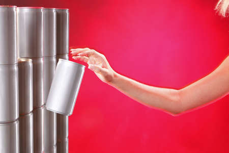 Aluminum can jumping out fron ahelve onto womans hand