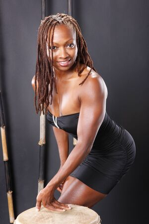 Cute and fit black girl with drum photo