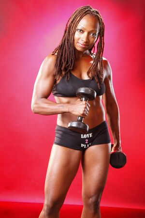 Toned african american and her dumbbell routine photo
