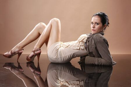 Fashionable young woman on mirrored floor
