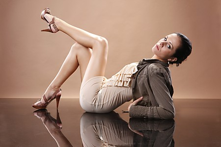mirrored: Fashionable young woman on mirrored floor