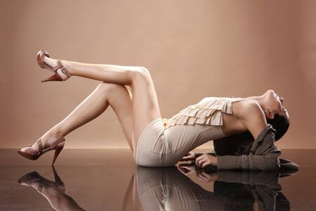 Fashionable young woman on mirrored floor photo