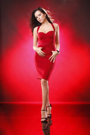 Cute brunette in red on red photo