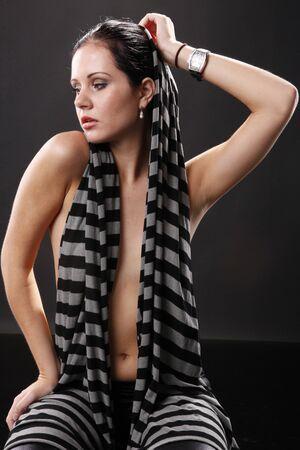 Cute brunette in stripe scarf photo