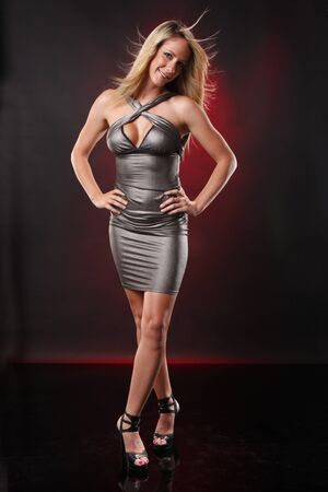Cute blond in silver dress photo