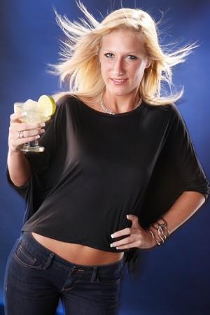 Next door girl enjoys a caipirinha cocktail photo