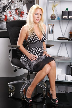 chairs: Sexy office dweller in a contemporary office