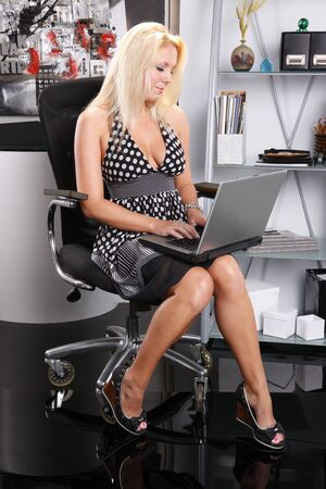 Sexy blond works with her laptop