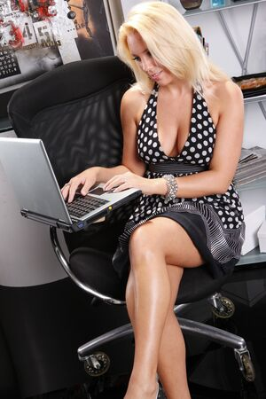 sexy black girl: Sexy blond works with her laptop