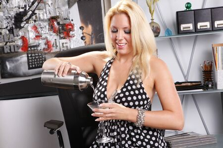 Sexy blond at her office with her martini