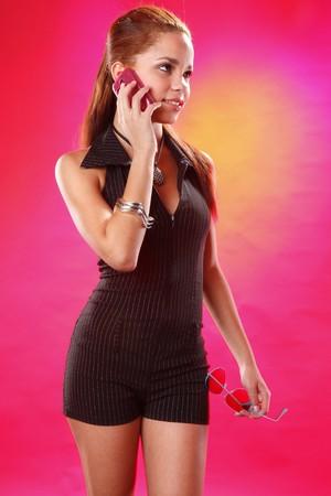 Cute teen on a cellphone call photo