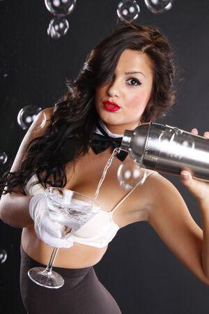 Cute brunette serves a martini among bubbles photo
