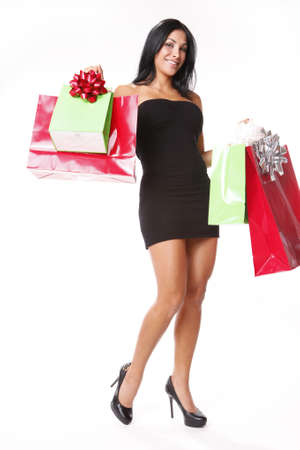 chrstmas: Young brunette shopping for Chrstmas gifts Stock Photo