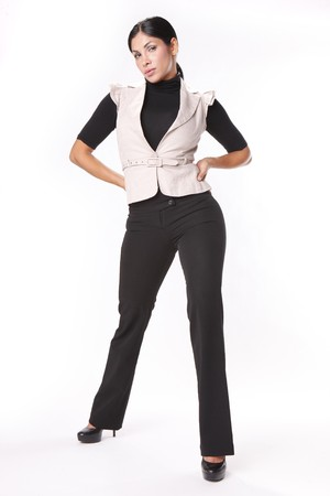 Young brunette in black slacks and cream vest photo