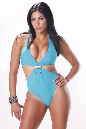 Stunning brunette in pastel blue swimsuit