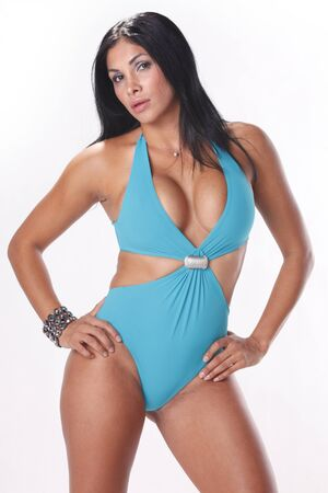 Stunning brunette in pastel blue swimsuit photo