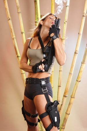 Tomb raider blows the smoke off her shotgun photo