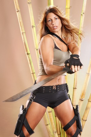 Tomb raider swings a machete Stock Photo - 8118197