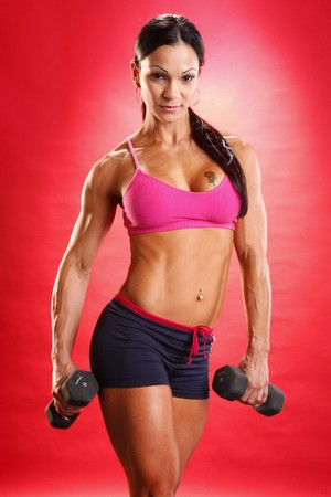 dumbbells: Fitness model and dumbbell routine Stock Photo