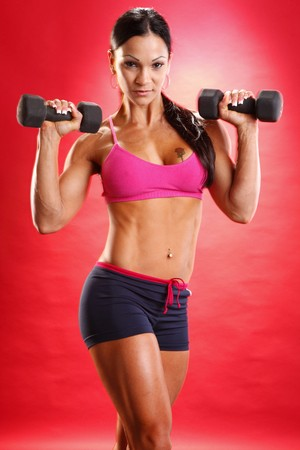 black out: Fitness model and dumbbell routine Stock Photo
