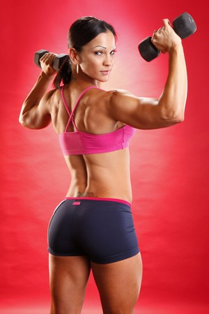 Fitness model and dumbbell routine Stock Photo