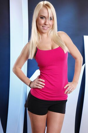 Young blond in tank top and shorts Stock Photo - 8160581