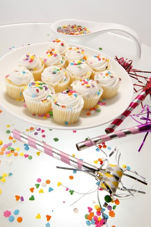 Snow white sprinkled fresh cupcakes photo