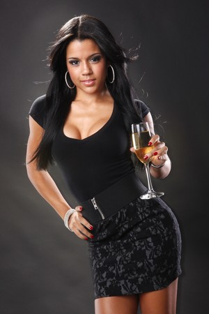 Cute brunette and wine in a flute Standard-Bild