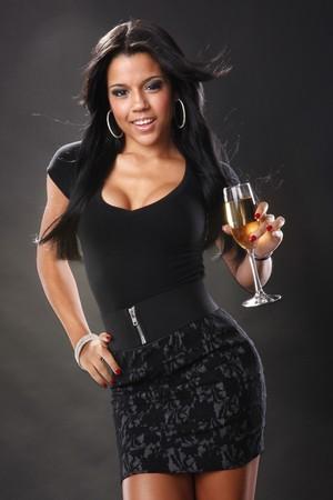 Cute brunette and wine in a flute photo