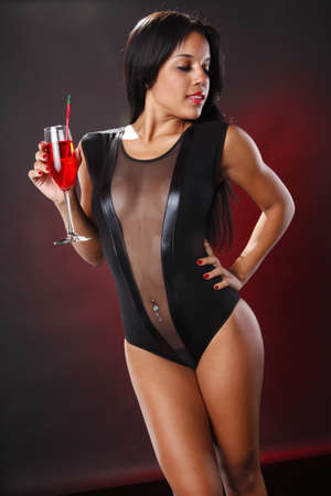 Cute brunette with cocktail on maroon photo