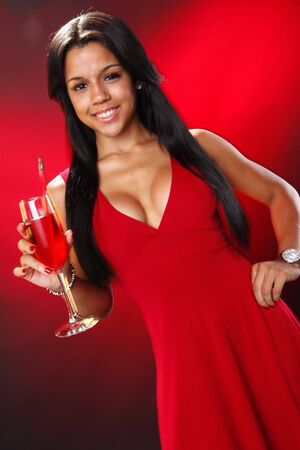 Cute brunette red with red cocktail photo