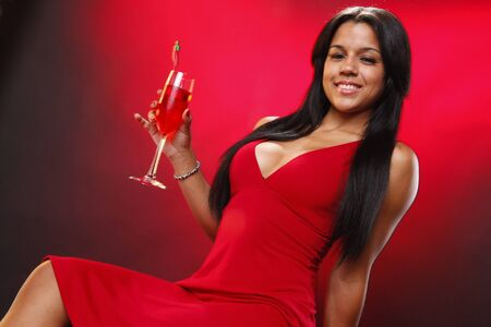 Cute brunette red shaking red cocktail photo