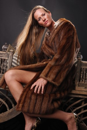 Female model and fur coat photo
