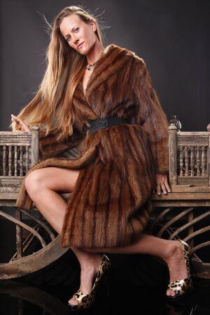 Female model and fur coat photo