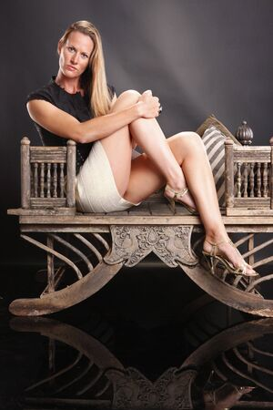 lounge: Female model and vintage Asian chair Stock Photo