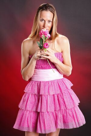 Blond woman in pink ruffles Stock Photo - 8191242